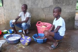 The Water Project: Lungi, Tintafor, #3 DelMoody Street -  Kids Cleaning Up Dishes