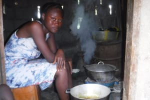 The Water Project: Lungi, Tintafor, #3 DelMoody Street -  Young Lady Cooking