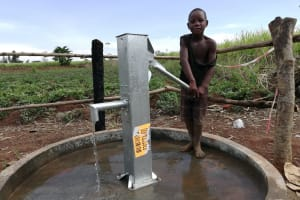 The Water Project:  Child Pumps Well