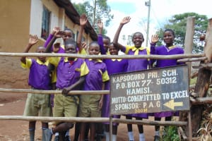 The Water Project: Kapsogoro Primary School -  Students Posing At The School Gate