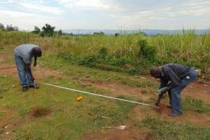 The Water Project: Mukangu Primary School -  Taking Measurements