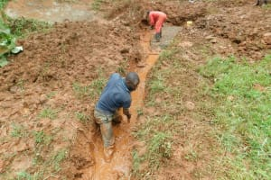 The Water Project: Mushina Community, Shikuku Spring -  Digging The Drainage Channel