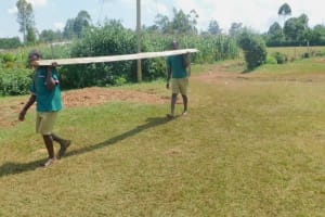 The Water Project: Shinyikha Primary School -  Students Use Teamwork To Deliver Lumber