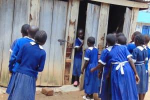 The Water Project: Mutiva Primary School -  Girls Using Latrines