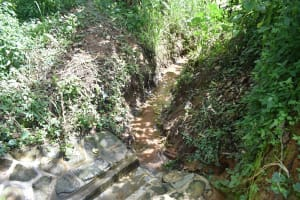 The Water Project: Mungakha Community, Asena Spring -  Good Drainage Channel Kept Cleared