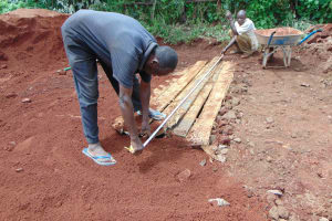 The Water Project: Womulalu Special School -  Measuring Latrine Area