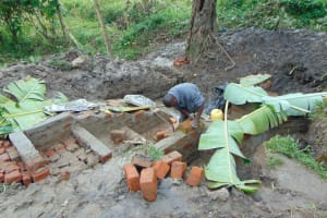 The Water Project: Bung'onye Community, Shilangu Spring -  Banana Leaves Protecting New Cement