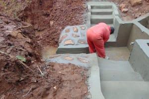 The Water Project: Hirumbi Community, Khalembi Spring -  Plaster Work