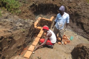 The Water Project: Emmachembe Community, Magina Spring -  Wall Construction