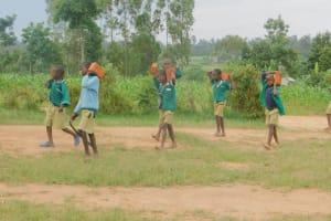 The Water Project: Elufafwa Community School -  Students Bring Bricks For Latrine Construction