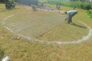 The Water Project: Shinyikha Primary School -  Weaving The Dome Wire Form