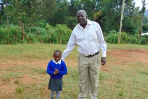 The Water Project: Kapsaoi Primary School -  Head Teacher Mr David Bengat With A Pupil