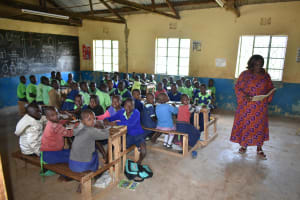 The Water Project: Khwihondwe SA Primary School -  Teacher Leads Students In Class