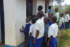 The Water Project: Mutiva Primary School -  Boys Line Up To Use Latrines