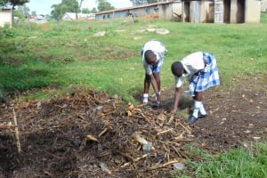 The Water Project: Friends Secondary School Shirugu -  Students Sweep Trash Into Garbage Pit