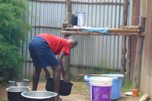 The Water Project: Malinda Secondary School -  Students Washing Dishes At The Dishrack