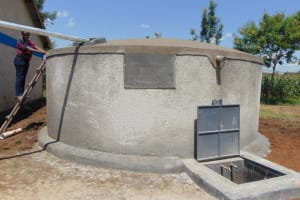 The Water Project: St. Margret Wadin'go Primary School -  Field Officer Inspects Rain Tank