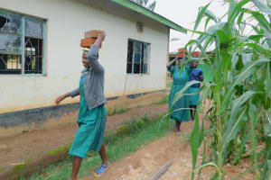 The Water Project: Elufafwa Community School -  Students Bring Bricks To The Latrine Worksite