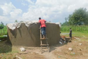 The Water Project: Shinyikha Primary School -  Attaching The Dome To The Tank