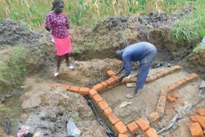 The Water Project: Sichinji Community, Kubai Spring -  Bricklaying On The Foundation