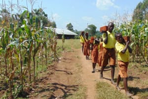 The Water Project: St. Margret Wadin'go Primary School -  Students Carry Bricks To Construction Site