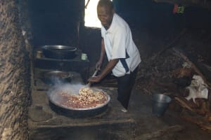 The Water Project: Friends Kuvasali Secondary School -  School Cook Preparing Students Lunch