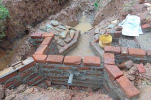 The Water Project: Shamakhokho Community, Imbai Spring -  Setting The Pipe