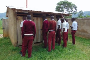 The Water Project: Friends School Ikoli Secondary -  Boys Queueing At Their Latrines