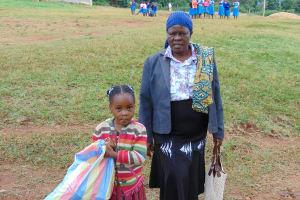 The Water Project: Kapsaoi Primary School -  Deputy Head Teacher Mrs Josephine Awinja With A Pupil