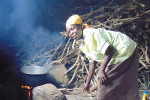 The Water Project: Kapkoi Primary School -  School Cook Joyce Kageha At The Kitchen Fireplace