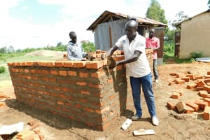 The Water Project: Enyapora Primary School -  Latrine Walls Going Up