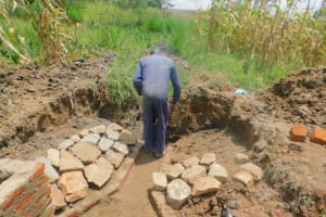 The Water Project: Sichinji Community, Kubai Spring -  Stone Pitching