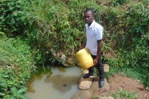 The Water Project: Friends Mixed Secondary School Lwombei -  Student Fetching Water