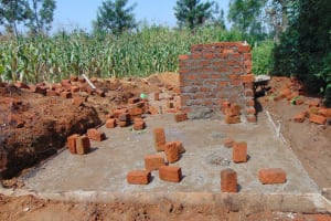 The Water Project: St. Margret Wadin'go Primary School -  Latrine Foundation And Start Of Walls