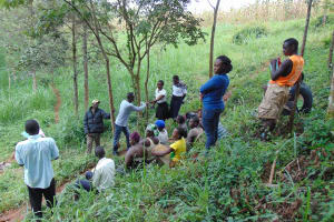 The Water Project: Mushina Community, Shikuku Spring -  Germ Transfer Demonstration By Shaking Hands