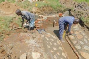 The Water Project: Sichinji Community, Kubai Spring -  Plastering Rub Walls