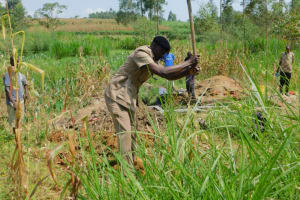 The Water Project: Sichinji Community, Kubai Spring -  The Assistant Chief Helps Dig The Diversion Channels