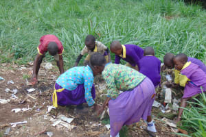 The Water Project: Kapsogoro Primary School -  Students Picking Rubbish On School Grounds