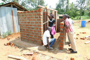 The Water Project: Enyapora Primary School -  Field Officer Inspects The Work