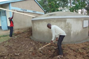 The Water Project: Ematiha Secondary School -  Attaching The Gutter And Clearing The Ground