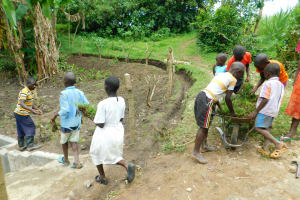 The Water Project: Bung'onye Community, Shilangu Spring -  Kids Help Deliver And Plant Grass
