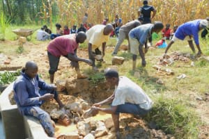 The Water Project: Sichinji Community, Kubai Spring -  Backfilling With Great Help From The Community
