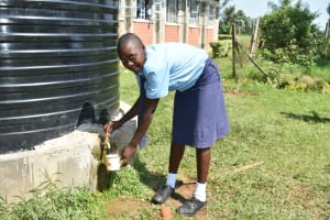 The Water Project: St. Peter's Khaunga Secondary School -  Student Collecting Water