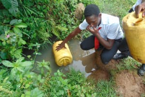 The Water Project: Friends Mixed Secondary School Lwombei -  Student Holding Nose Against Waters Smell