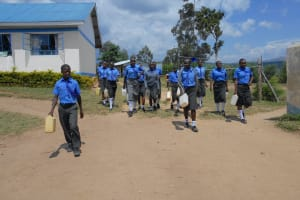 The Water Project: Malinda Secondary School -  Students Carrying Jerrycans To Go Fetch Water