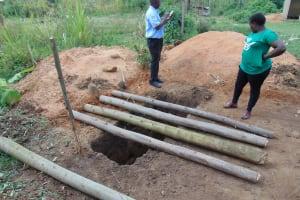The Water Project: Mukangu Primary School -  Team Leader Catherine Chepkemoi Supervising Latrine Work