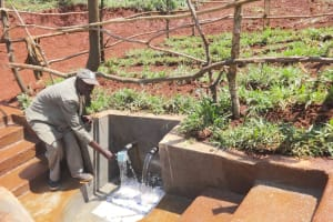 The Water Project: Mushina Community, Shikuku Spring -  Getting A Drink From The Spring