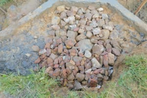 The Water Project: Sichinji Community, Kubai Spring -  Backfill Layer Of Stones