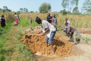 The Water Project: Sichinji Community, Kubai Spring -  Mobilizing Clay For Backfilling