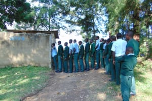 The Water Project: Friends Kuvasali Secondary School -  Boys Queue To Use Latrines